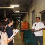 HCC's Mike Roth (Kitchen Manager) shows the JTB Hawaii group HCC's food scrap refrigeration unit where food wastes are held and waiting for pick-up.