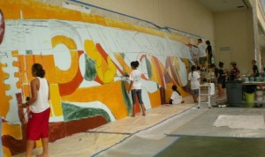 working on the hawaii kakou mural at the hawaii convention center