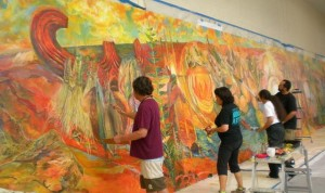 Al Lagunero, Meleanna Meyer, Harinani Orme, and Solomon Enos put on the final touches of the Hawai`i Kakou Mural
